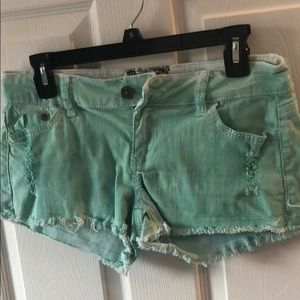 Mint colored jean shorts